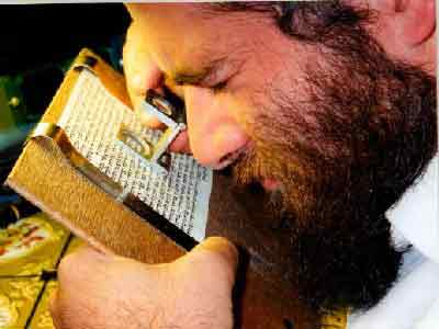 Examining a mezuzah scroll
